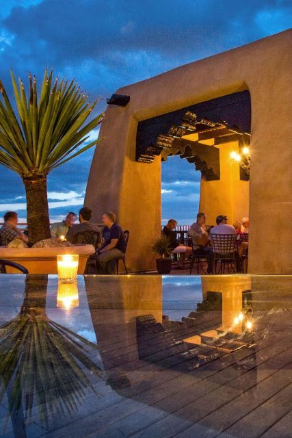 Best place to dinner out and look Locals and guests alike flock to La Fonda's rooftop Bell Tower Bar for sunset cocktails. La Fonda on the Plaza Santa Fe, New Mexico. Santa Fe vacation rental, Cozy historic adobe home in town walking distance to the plaza, 2 bedrooms and experience fine dining, shopping, explore galleries, museums and attend classes of your interest. You might want to think about September and Fall as well - beautiful in Santa Fe! www.airbnb.com/rooms/2562597 #airbnb