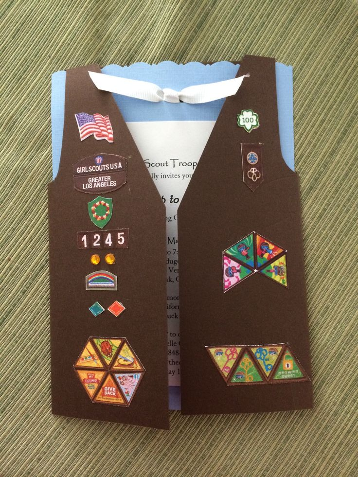 "Invitations we made for our ""fly up"" to Junior bridging ceremony. They turned out great! I took my daughter's Brownie vest and scanned the badges. Then shrunk the scanned images to size, printed them, and cut & pasted them on the vest card. Super easy!"