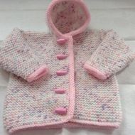 Hand knitted baby hooded jacket Newborn size - actual chest measurement 17 inches This lovely little jacket has been knitted in an acrylic speckle yarn which is white with specks of pink, lilac, mint and peach The edges of the hood, sleeves and fronts ...
