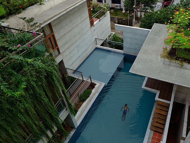 shatotto constructs a private concrete oasis: mamun residence