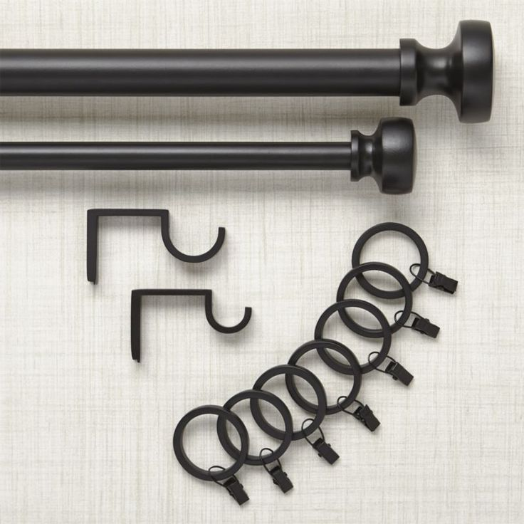 Classic knob finial in chic matte black adds definition to hanging sheers and curtains. Telescoping rod sets include rod, finials, brackets and mounting hardware in your choice of two diameters. Optional coordinating easy-glide curtain rings finish the look.<br /><br /><NEWTAG/><ul><li>Iron and aluminum rod, finials, mounting brackets</li><li>Black powdercoat finish</li><li>Rod sets include one telescoping rod in chosen diameter, two finials, mounting hardware and brackets- two brackets…