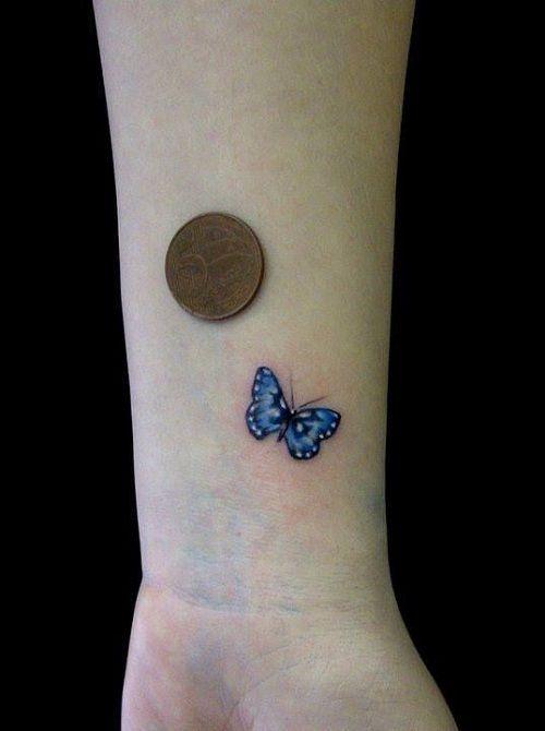 Tiny Blue Butterfly on Wrist Tattoo