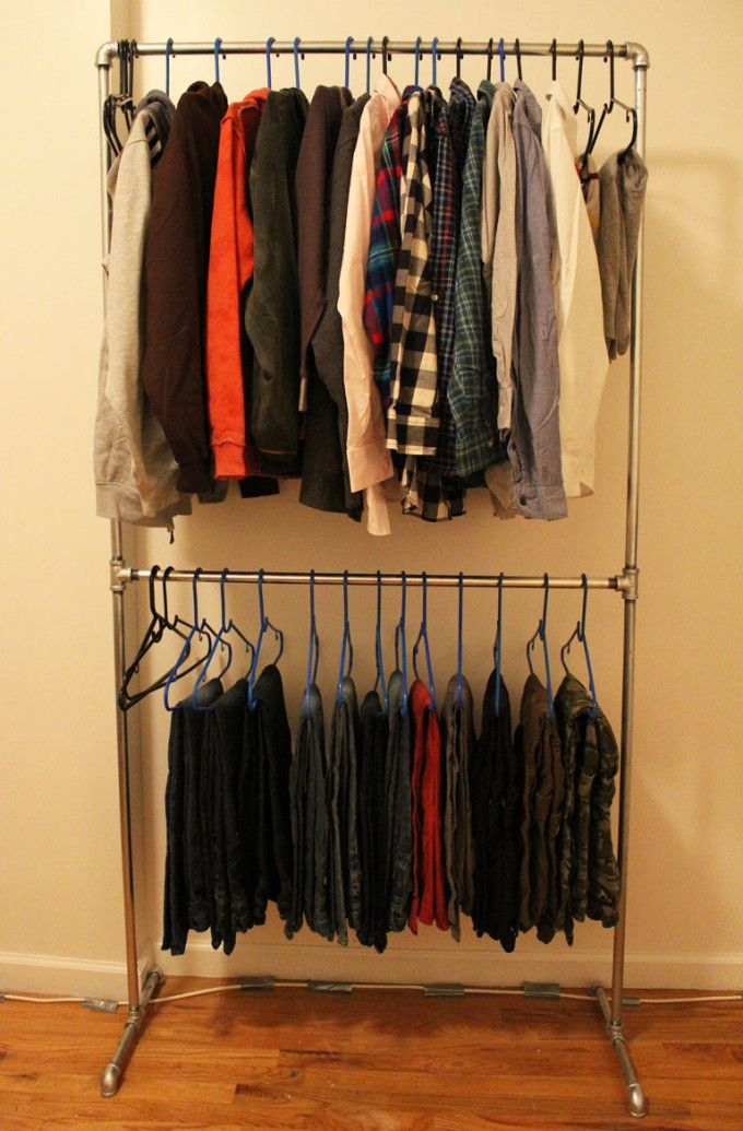 Heavy duty DIY clothing rack made from pipes - great for apartments or homes with limited closet space.