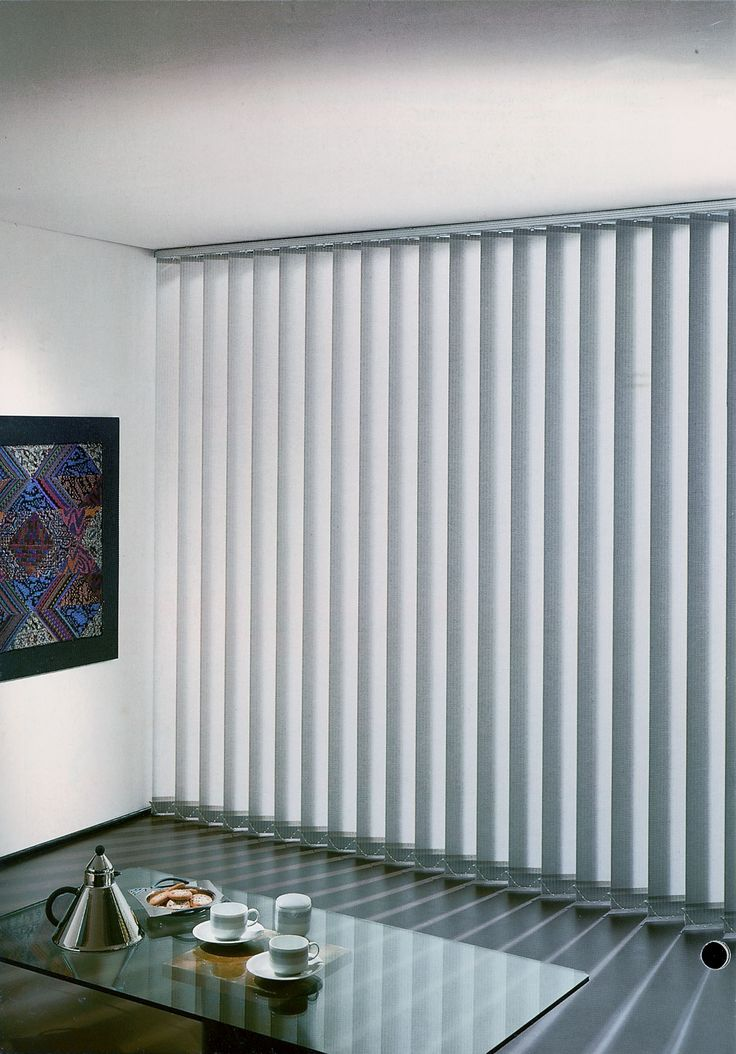 Decor: Snazzy White Fabric Levolor Vertical Blinds On Brown Wall Paint Plus White Fur Rug And Cool Chairs Also Stainless Glass Top Table For Home Interior Design