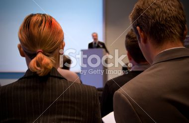 Business conference with lecturer and audience Royalty Free Stock Photo