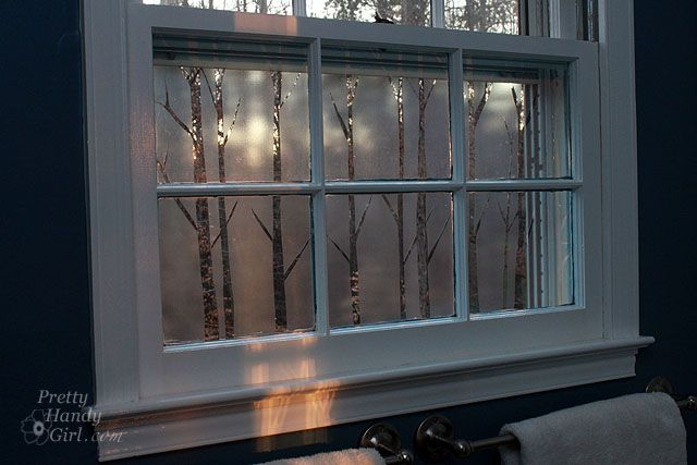 Privacy film and tree silhouettes in bathroom window. No more peeping toms!