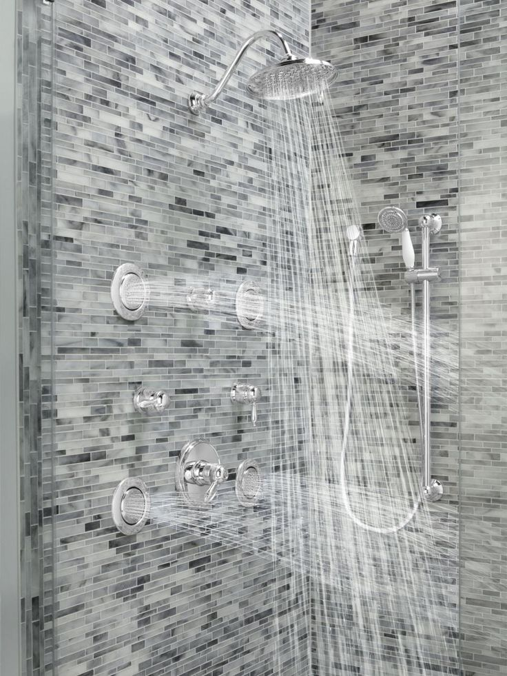 Body sprayers, which are integrated into the shower wall and can be adjusted to massage the body or produce a relaxing mist, add another layer of luxury to the shower experience. Image courtesy of Moen