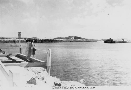 #ThrowBackThursday Mackay Harbour 1940 - 1950 from the seaward end of the southern breakwater. Over to the left the breakwater was blasted to provide an entrance into the Mackay Marina. In the centre is the Breast Wharf; Mt. Bassett with quarry from which stone was used to build the Harbour.