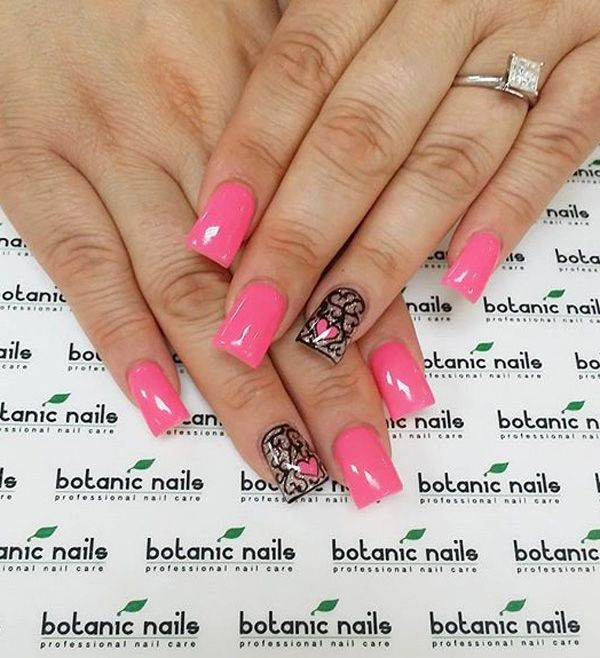 Cute and adorable looking pink nail art design. This nail art design uses pink as base color as well as clear nail polish. A cute heart detail and squiggly lines are painted on top using black nail polish.