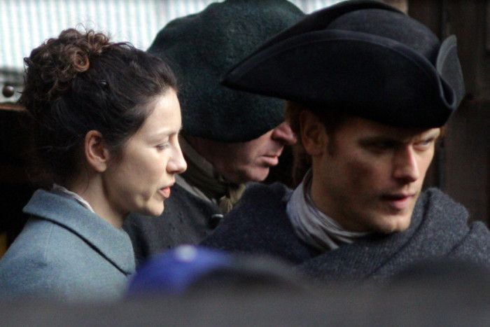 Caitriona Balfe, left, and Sam Heughan were filming in Edinburgh today. Picture: SWNS