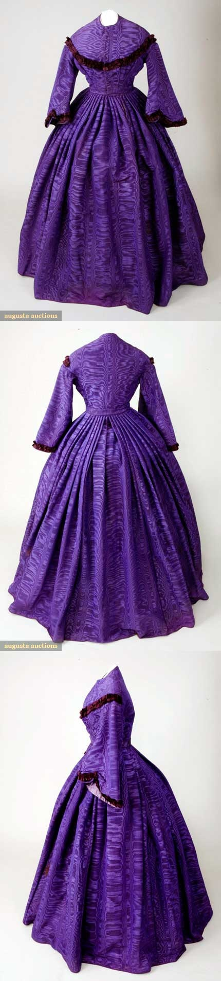 Dress, 1862-1865. Purple ribbed moiré silk, trimmed with pinked and tucked burgundy silk. Collarless neckline, front hook closure, padded bodice fitted & trimmed with pinked silk in diagonal line to shoulders. Wide pagoda sleeves, inset waistband, full knife-pleated skirt with 1 pocket in seam. Three different fabric linings: lavender silk, brown cotton, and glazed cotton. Augusta Auctions