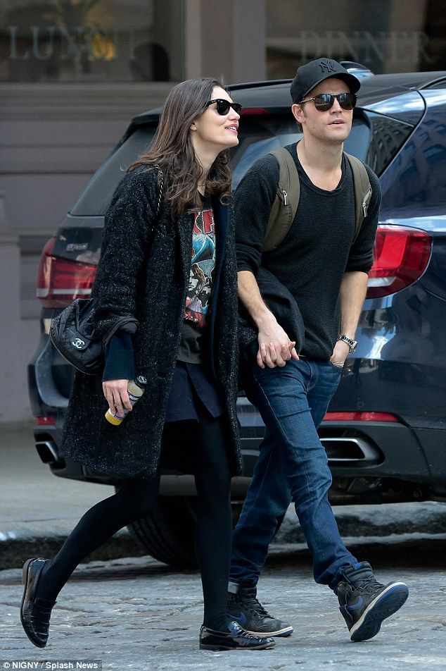 Loved up: Phoebe Tonkin and boyfriend Paul Wesley looked happy and relaxed in each others ...