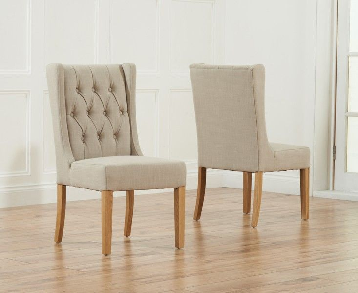 Buy the Safia Beige Fabric Oak Leg Dining Chairs at Oak Furniture Superstore