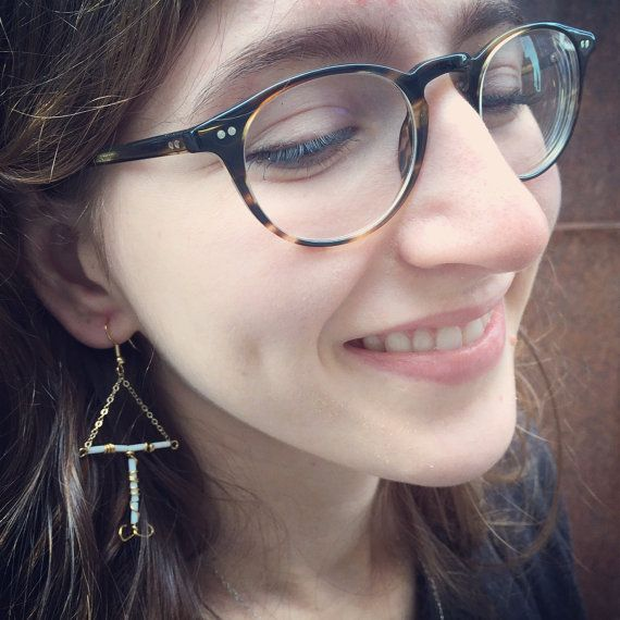 IUD look-a-like earrings (the non-hormonal kind) - made out of gold filled wire, chain, and beads. Order them with the usual white beads, or