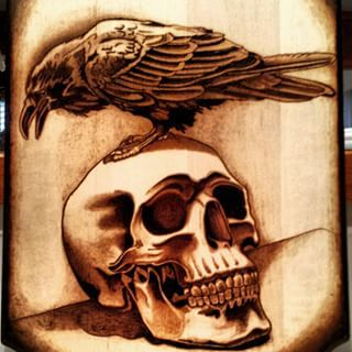 Instagram photo by macdougall_pyrography - Skull and crow.. #pyrography #woodburning #art #photorealism #pyroart #colorado #coloradoart #coloradoartist #pyrographyart #jessemacdougall #skull #crow #macdougallpyrography #tattoo #woodtattoo #skullart #skullartwork