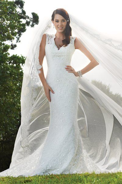 This wedding dress has it all! Lace, sparkle, sweetheart neckline, and a gorgeous slim sheath silhouette. Perfect for a garden wedding! {Sophia Tolli}