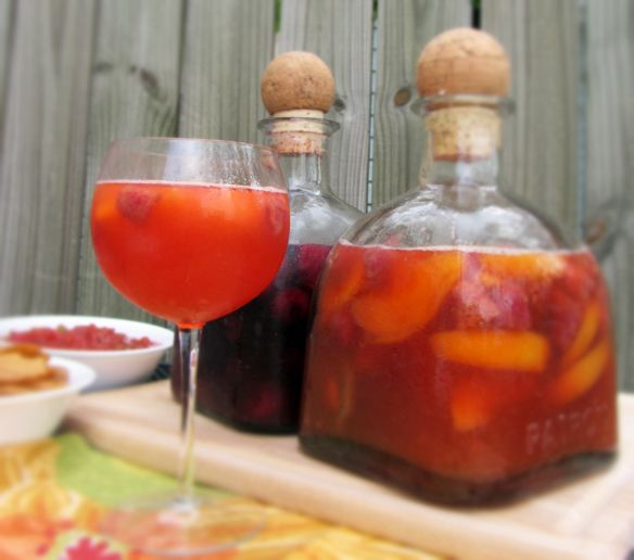 raspberry peach and strawberry lime sangria recipes! perfect for the warm weather- why didn't i think of keeping the patron bottles?
