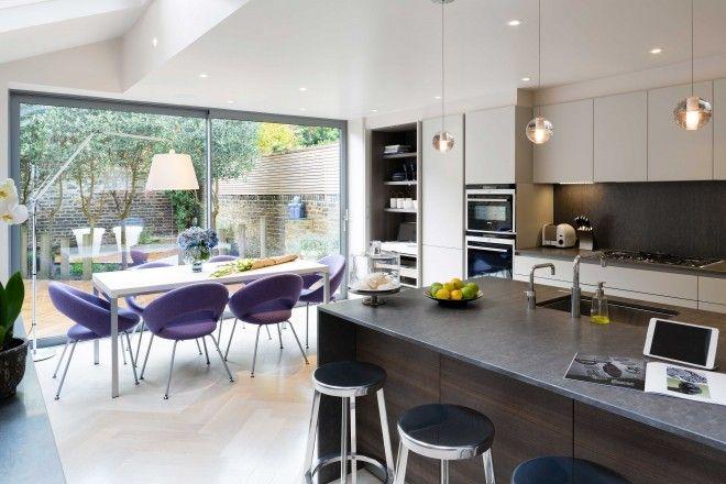 Fulham – Londra | Cesar -- Dark Backsplash & Island, Light Cabinets, Pop of Purple