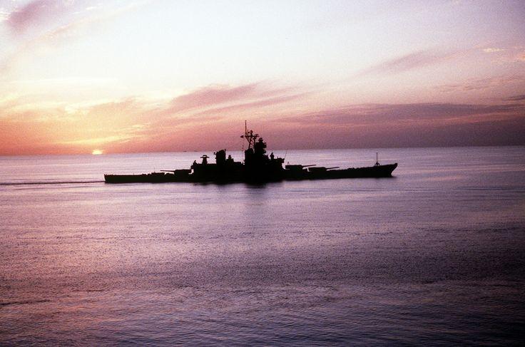 https://flic.kr/p/65psCV | DN-ST-93-00643 | The setting sun silhouettes the battleship USS MISSOURI (BB-63).