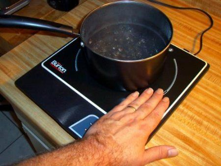 An induction cook top is very safe and uses electricity, not expensive propane!