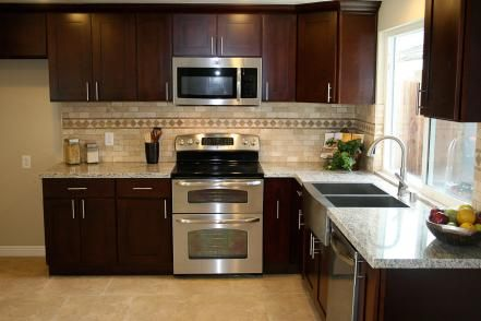remodels yellow cabinets dark cabinets hgtv kitchens small kitchens