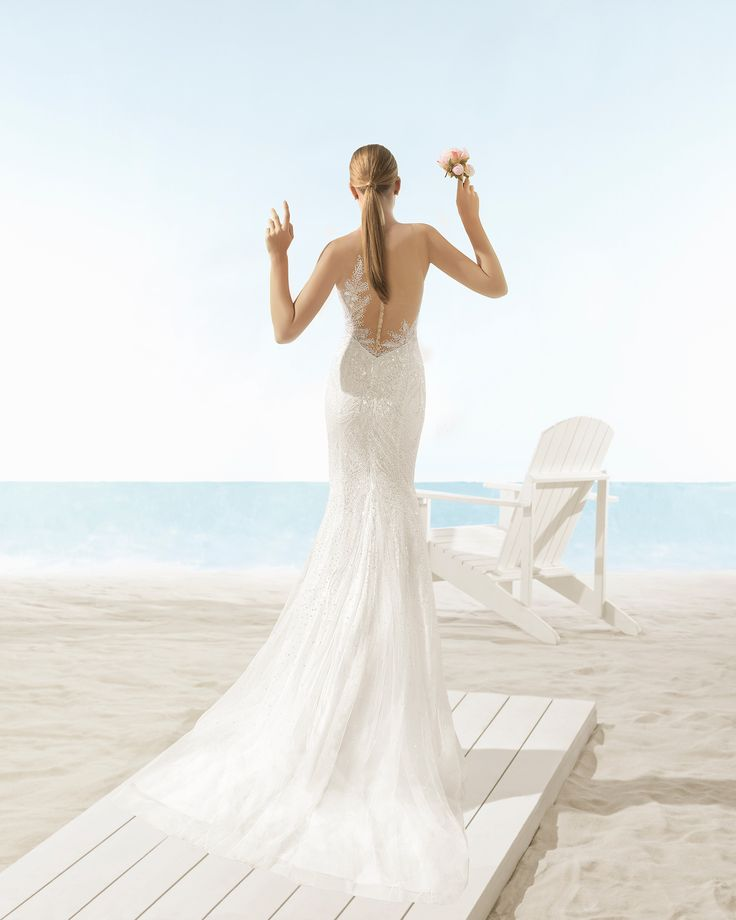 Mermaid-style beaded tulle wedding dress with sweetheart neckline and very low back, in natural/nude.