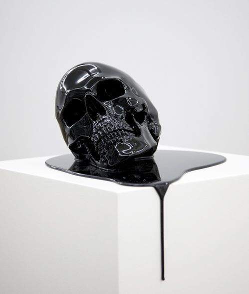 gives the impression of a mortal kombat esq acid bath as a bleeding skull might have skin