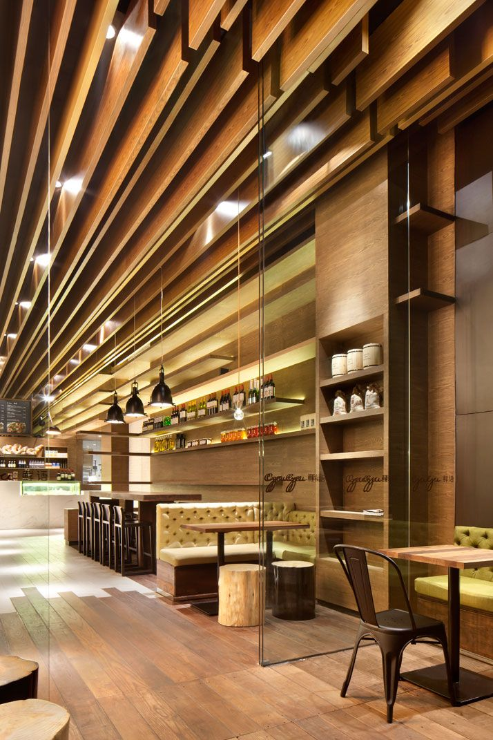 GAGA Deli And Eatery In Shenzhen@ Coordination Asia | wooden paneling,Cushioned seating areas, ceiling installation of lamellas which create a cozy light