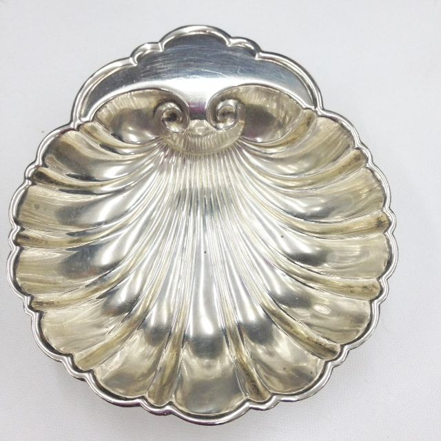 One of a pair of sterling silver shell dishes.