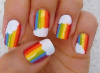 These rainbow themed nails are really cute.