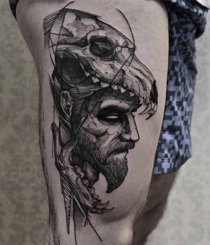 thigh tattoo man in a wolf skull
