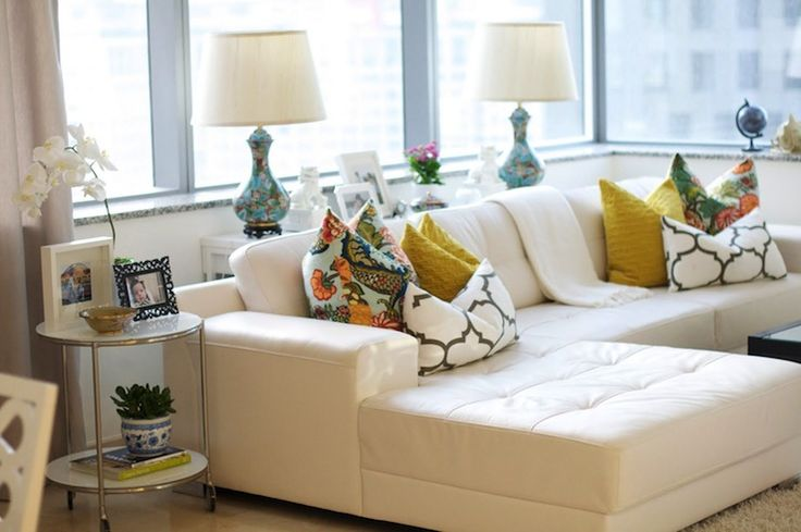 living rooms - white tufted leather sofa sectional chaise lounge turquoise lamps yellow basketweave pillows Chiang Mai Dragon - Aquamarine Windsor Smith Riad Fabric
