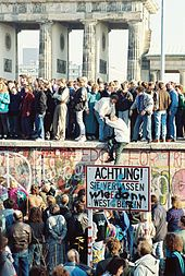 "The Fall of the Berlin Wall: The date on which the Wall fell is considered to have been 9 November 1989 but the Wall in its entirety was not torn down immediately. Starting that evening and in the days and weeks that followed, people came to the wall with sledgehammers or otherwise hammers and chisels to chip off souvenirs, demolishing lengthy parts of it in the process and creating several unofficial border crossings. These people were nicknamed ""Mauerspechte"" (wall woodpeckers)."
