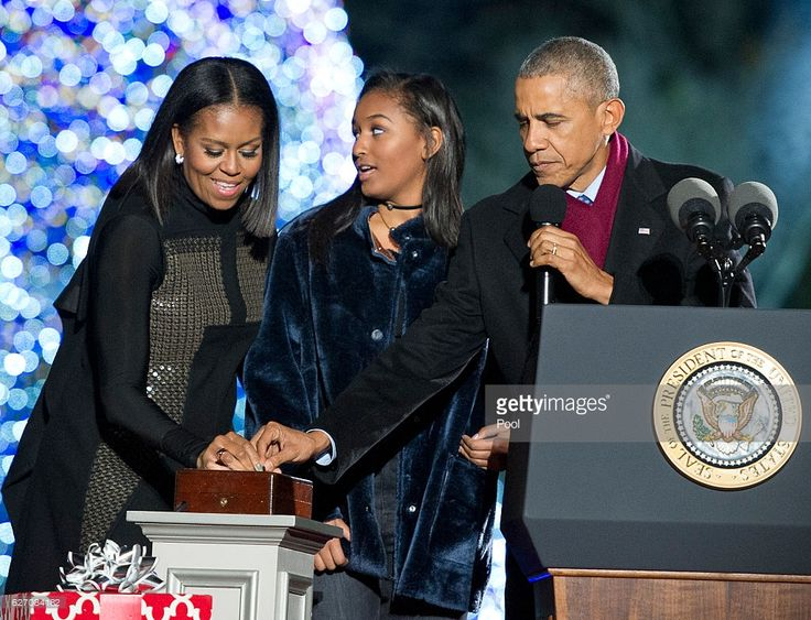 U.S. President Barack Obama, first lady Michelle Obama and Sasha Obama trip the switch at the National Christmas Tree Lighting on the Ellipse December 1, 2016 in Washington, DC. This year is the 94th annual National Christmas Tree Lighting Ceremony.