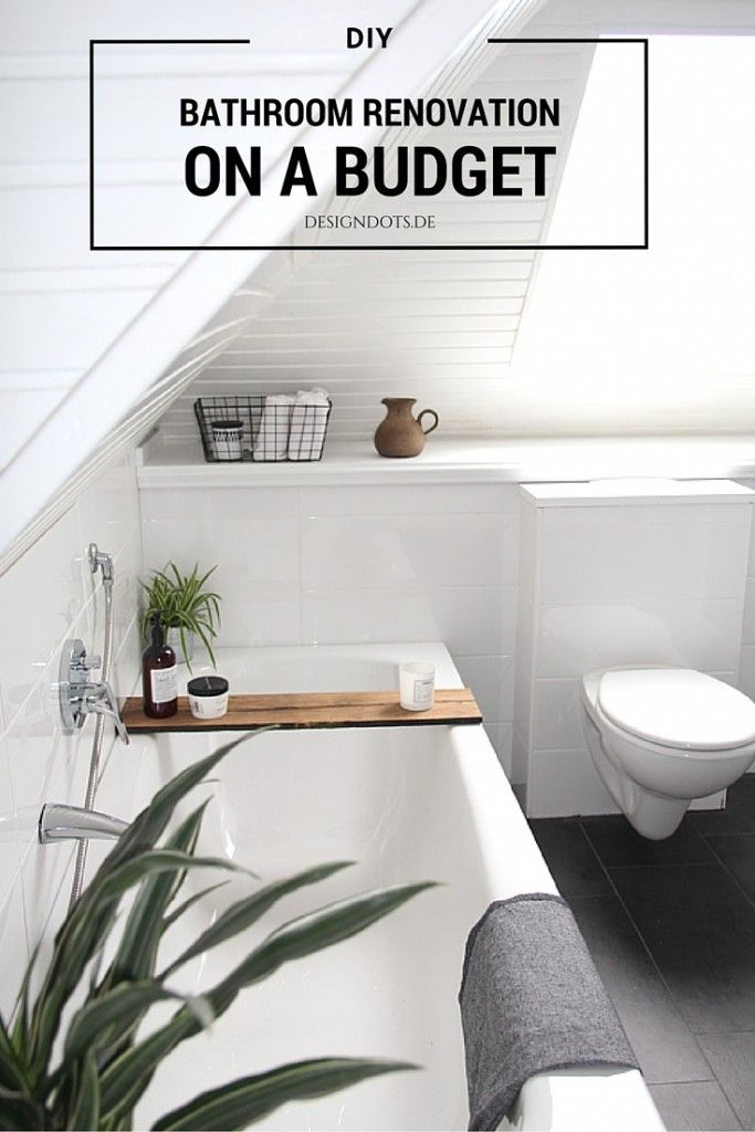 Bathroom renovation on a budget I white grey scandinavian style with green plants and wooden details
