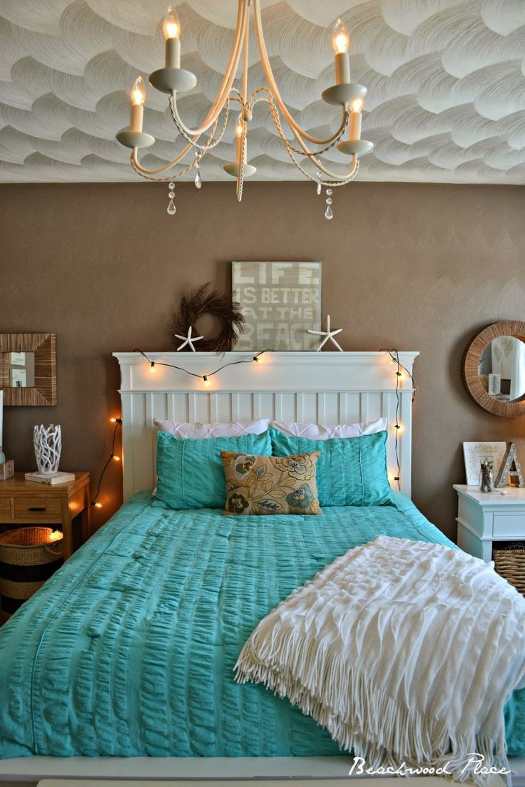 We love all the elements in this mermaid beach inspired master bedroom.
