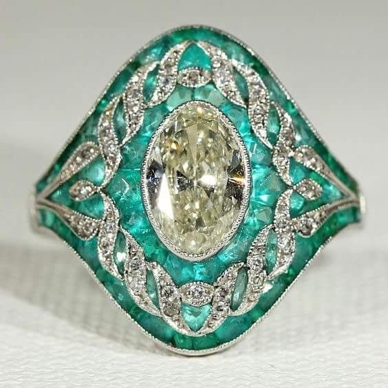 An Edwardian emerald and diamond ring mounted in platinum.