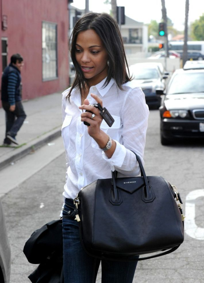 Blue jeans, white shirt, Givenchy bag.