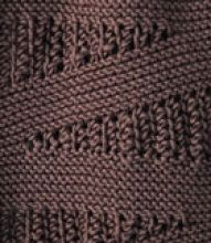 Wedge is a garter stitch scarf with clever short rowed lace inserts.