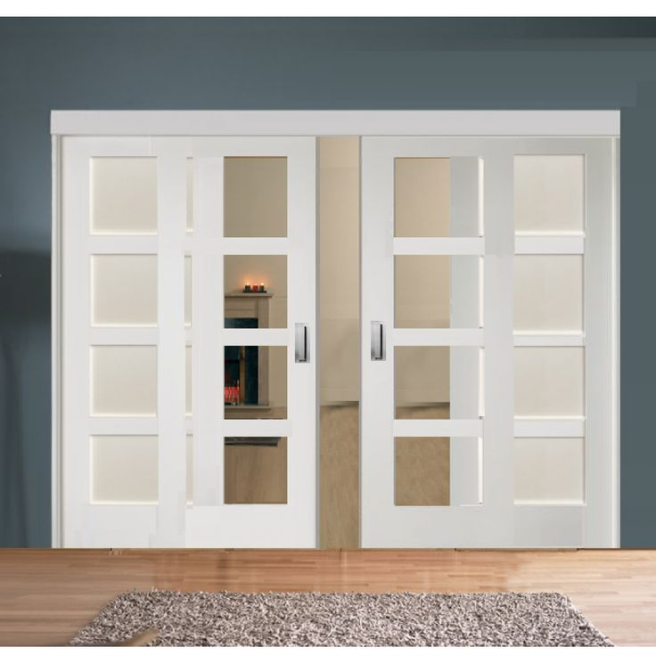 sliding room divider with white shaker glazed solid doors