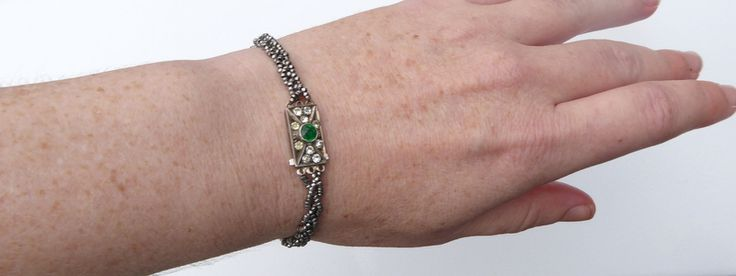 This bracelet contains three strads of platted cut steel beads connected with a stunning vintage Art Deco paste clasp.