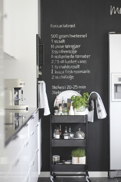 the chalkboard wall and the ikea industrial chic kitchen cart.