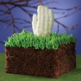 Your homemade Halloween brownies come alive with a high five from below! Treats are easy to dress up—just pipe pull-out grass on top and add a bony hand molded with the Wilton Halloween Bones Candy Making Kit.