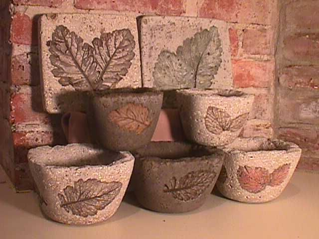 These are Hypertufa pots made by Billie ann on Garden Web site...there is a ton of information on how to make the hypertufa mix and what works best for people...including what to use for molds, techniques that work or don't..., painting...etc...lots of info