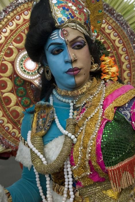 India, Kerala State, Thiruvananthapuram (Trivandrum) 2012. An actor represents the dual character of Shiva (blue) and his consort Parvati. She is a 'hijra', a holy transsexual. by Abbas