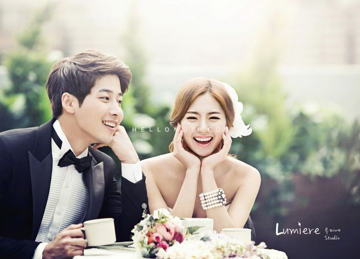 Groom and bride is smiling having a tea together