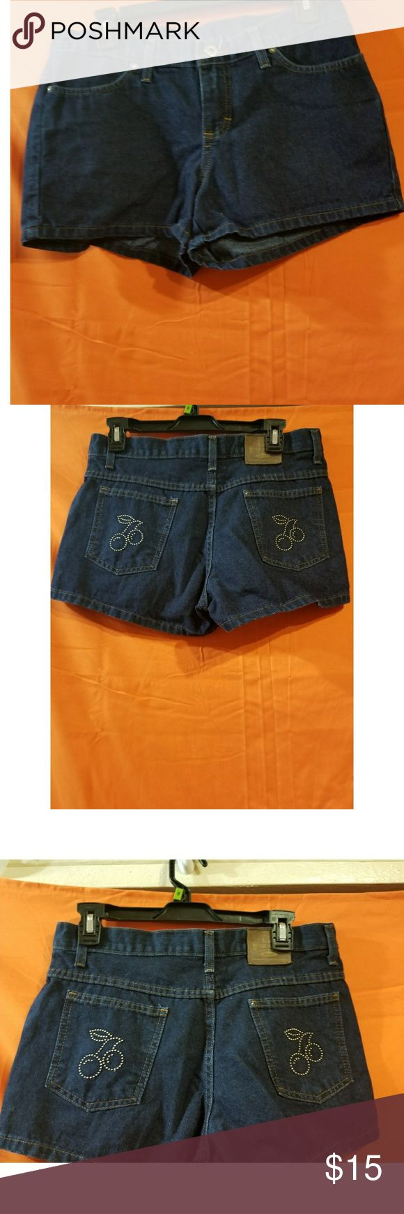 Lee Dungarees Navy Blue Shorts w/cherry Lee Dungarees navy blue  Size 7 Cherry pattern on back short pockets Belt loop shorts  READY to ship today Great used condition #shorts #shopmycloset #shopping #chic #summer #instachic #fashionista #vacation #lee #dungarees #shorts #cherry #cherries #denim #jeans Lee Shorts Jean Shorts