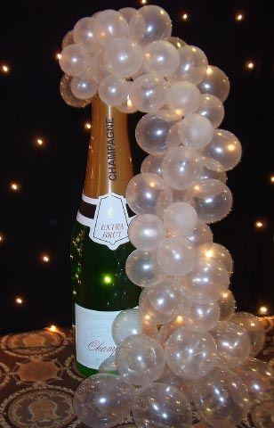Balloon bubbles set a celebratory mood and the blacklit backdrop sets it off