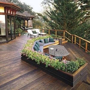Deck with built in planters and seating that looks out.  Love the deck color