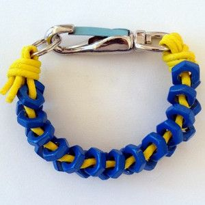Make a vibrant jewelry piece, and create this Bold Kenzo Nut Bracelet. This DIY knockoff bracelet is a fun version of a Kenzo Nut Bracelet, with just as much style, but not as high of a price